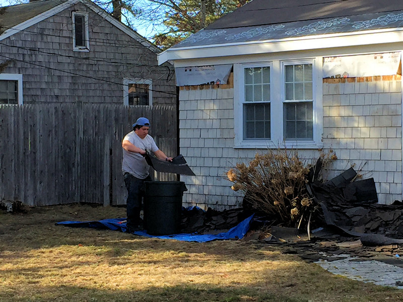 wood siding shingles being removed