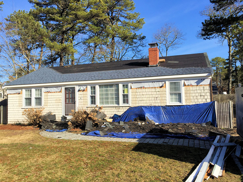 Roof nearing completion - wood siding shingles being removed